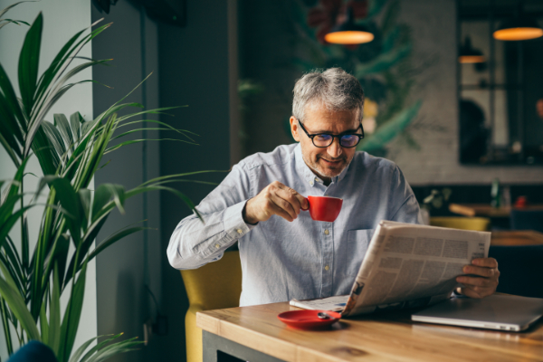 MED-business-man-reading-paper-600px