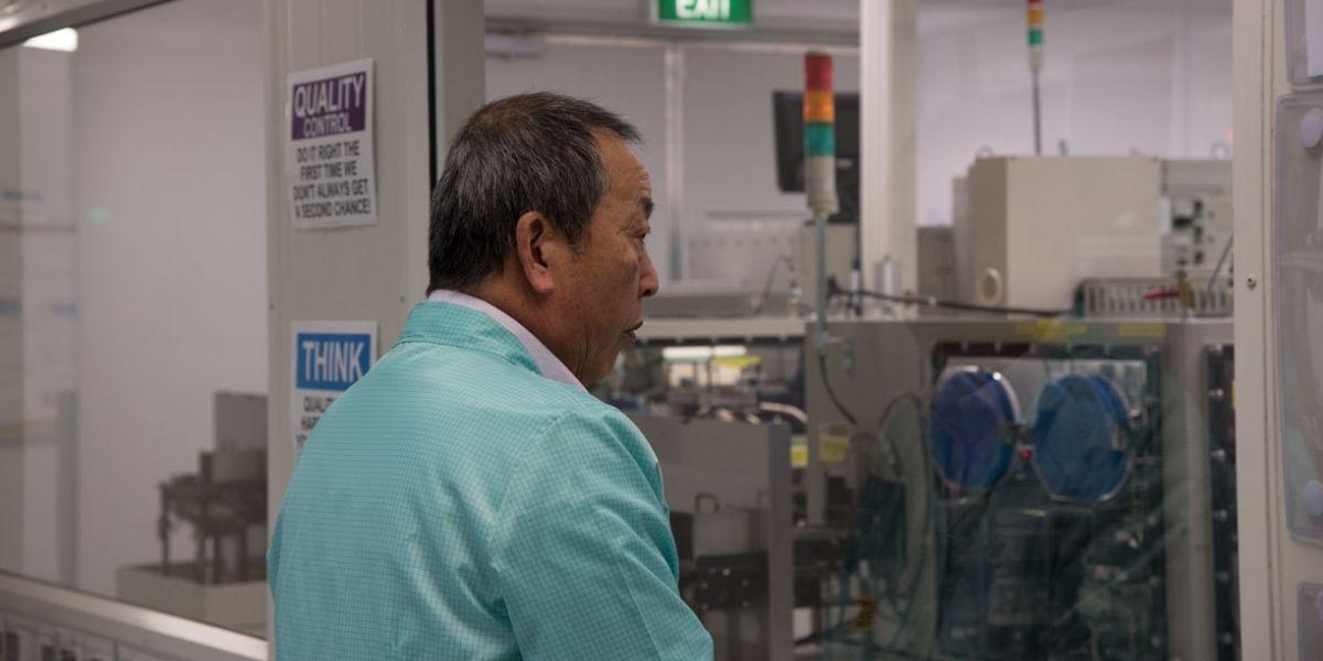 Lean Consultant Akinori Hyodo observing the Cleanroom